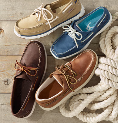 Four colorful boat shoes on a dock.