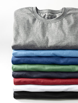 Stack of colorful Unshrinkable Tees.