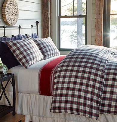 Bedroom with flannel bedding.