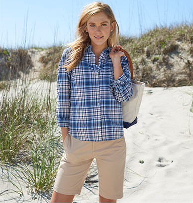 Woman on beach in button down shirt