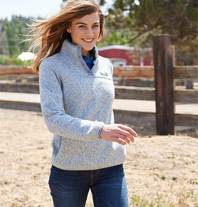 Woman smiling as she walks in an active fleece