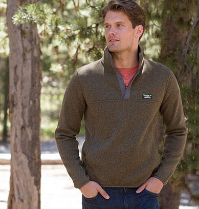 Man standing by tree in Sweater Fleece
