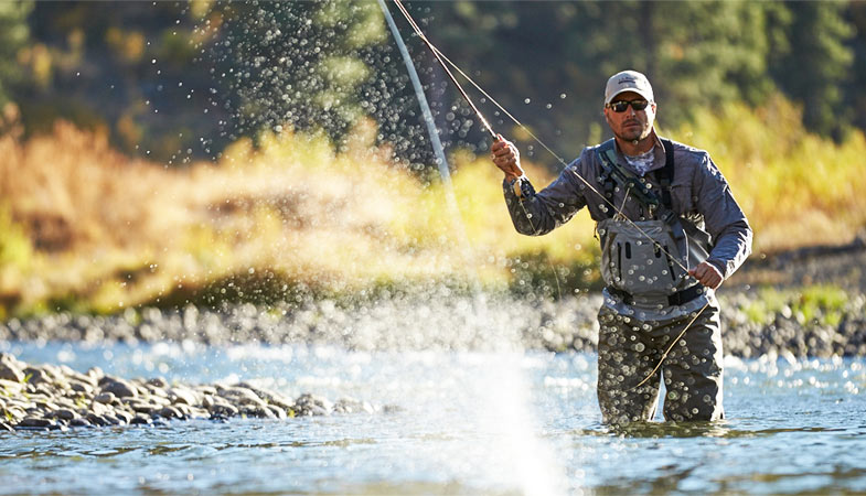 image of man fly fishing