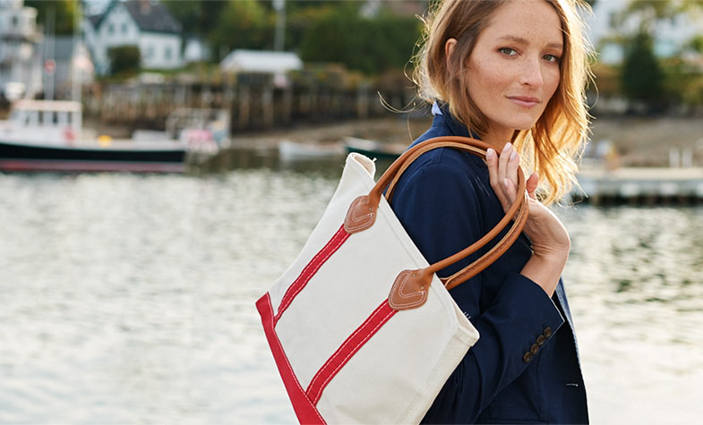 Woman carrying Boat and Tote Bag