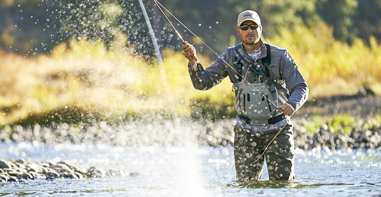 Image of man fly fishing.