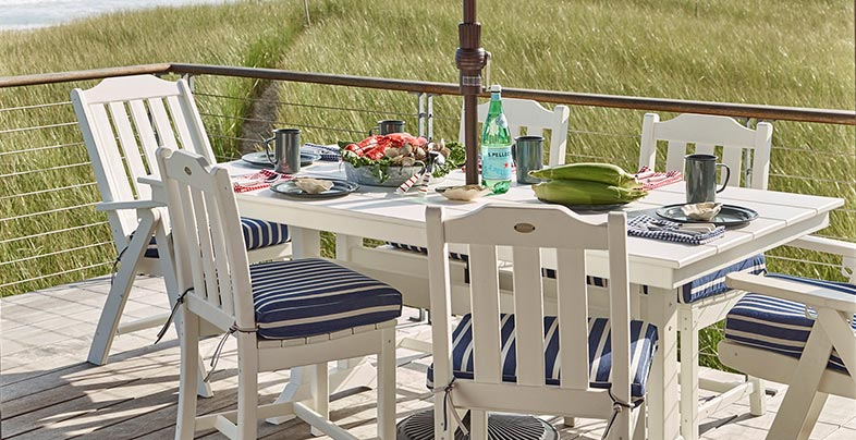 All-Weather adirondack dining furniture on a deck.