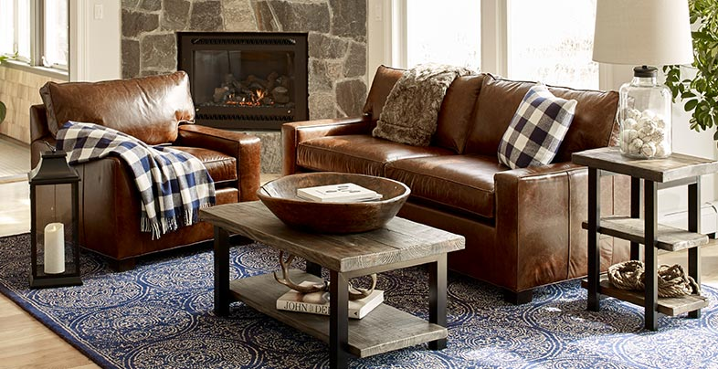 Portland Furniture chair and sofa in front of a fireplace.