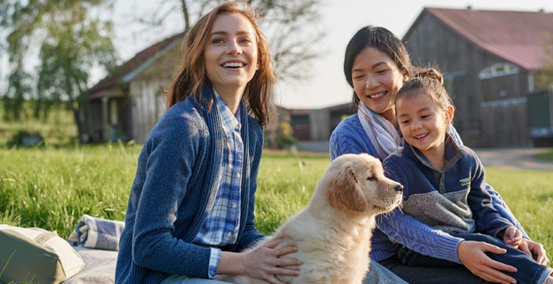 Two women with kids and dog in L.L.Bean Clothes Enjoying the day outdoors