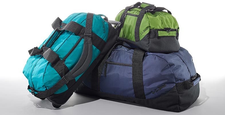 three duffle bags in different sizes and colors.