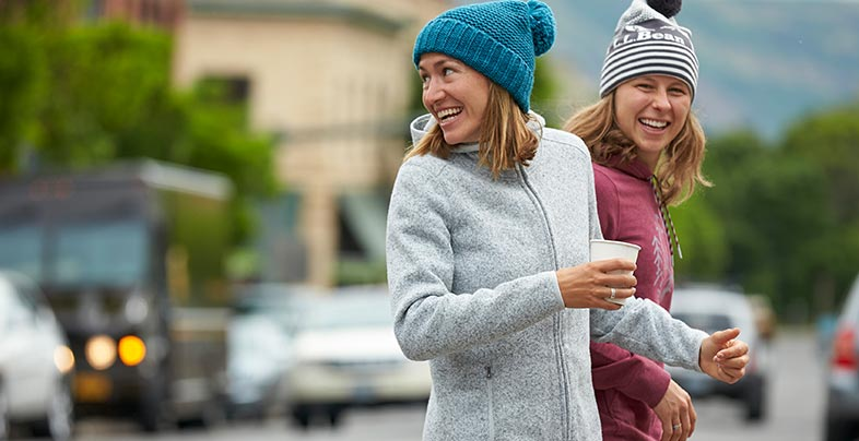 two women crossing street in city wearing L.L.Bean clothes from the Town and Trail Collection.