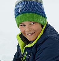 Smiling boy in L.L.Bean jacket and hat.