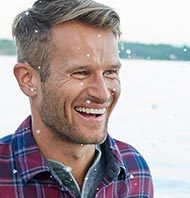 Man smiling in an L.L.Bean flannel shirt.
