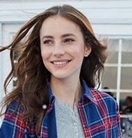 Woman in an L.L.Bean Flannel Shirt.