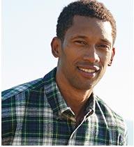 Man in a Scotch Plaid Flannel Shirt.