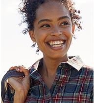 Woman in a Scotch Plaid Flannel Shirt.