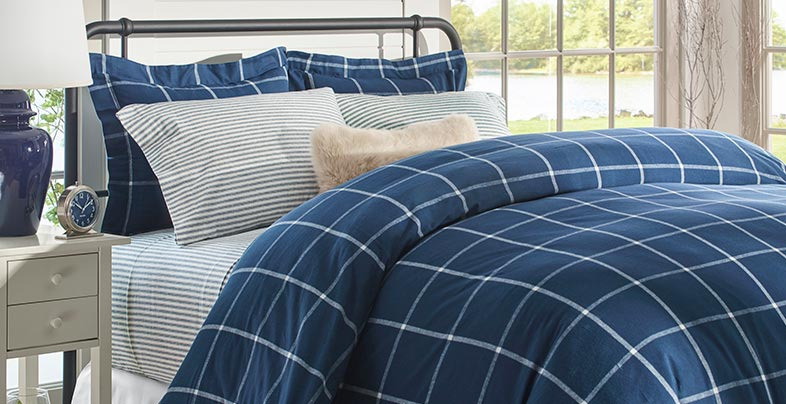 Bed with flannel sheets and comforter.