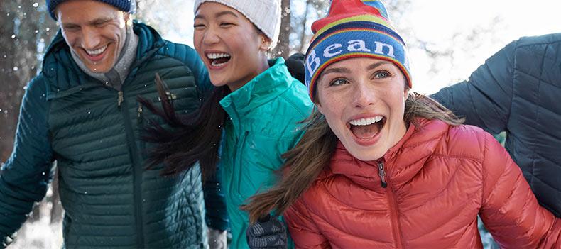 Friends enjoying a winter day outside wearing L.L.Bean outerwear.