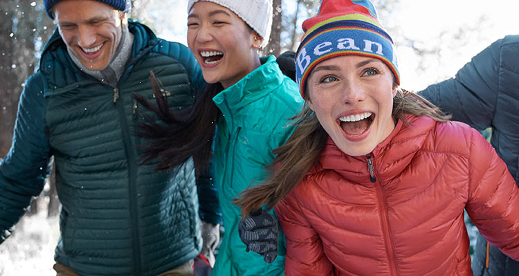 Friends enjoying a winter day outside wearing L.L.Bean outerwear.