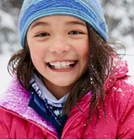Smiling girl in an L.L.Bean jacket.