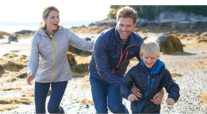 Family in L.L.Bean jackets running on the beach.