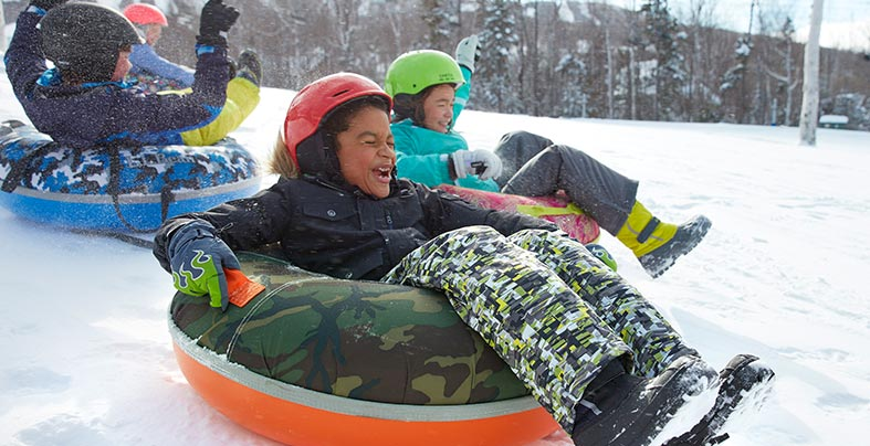 Children snow tubing.