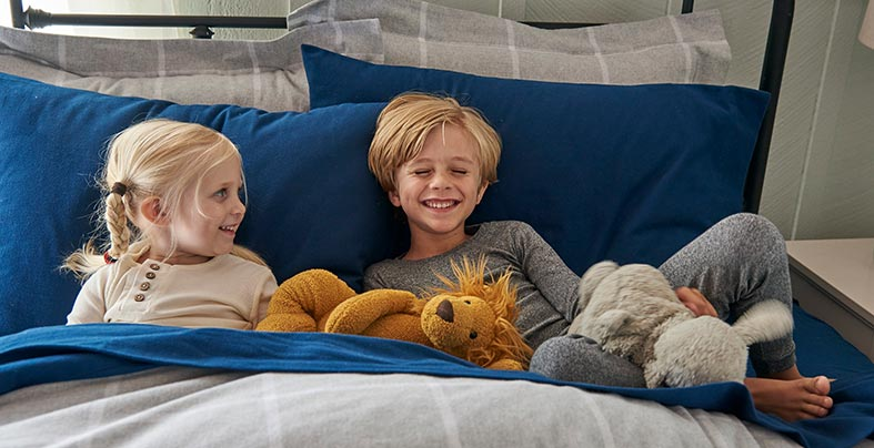 Kids with stuffed animals.