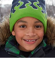 Boy in an L.L.Bean jacket and hat.