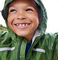 Smiling boy in L.L.Bean rainwear.
