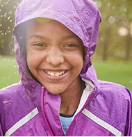 Smiling girl in L.L.Bean rainwear.