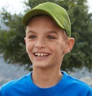 Smiling boy in L.L.Bean baseball cap and shirt.