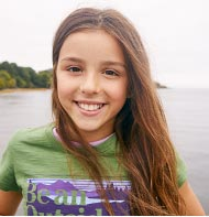Smiling girl in an L.L.Bean graphic tee.