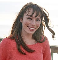 Smiling woman in a red L.L.Bean shirt.