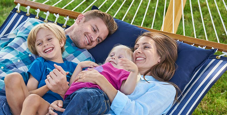 Family relaxing on an L.L.Bean hammock.