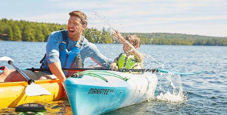Family splashing in Manatee Kayaks.