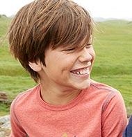 Boy wearing L.L.Bean shirt outside.