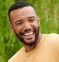Man wearing L.L.Bean shirt outside.
