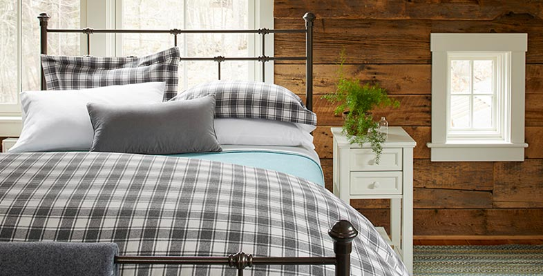 Cozy bedroom with L.L.Bean flannel sheets on the Lakehouse bed.