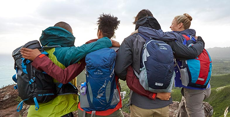 Friends celebrating a summit hike with L.L.Bean gear.