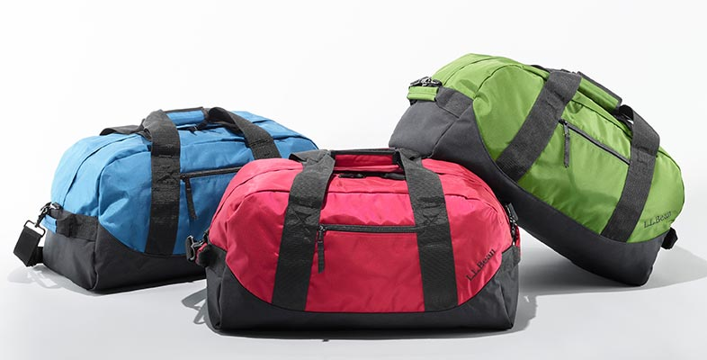 An assortment of L.L.Bean Adventure Duffles.