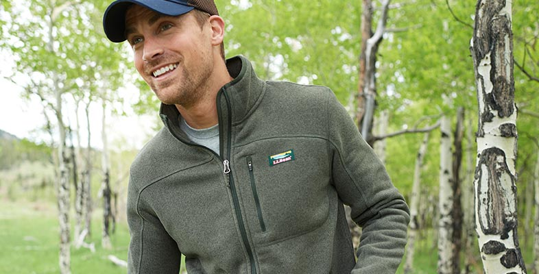 Man hiking in the woods wearing L.L.Bean fleece.