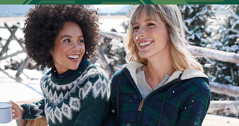 Two women enjoying a winter day wearing L.L.Bean flannel.
