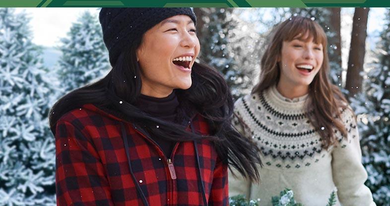 Two women enjoying a winter day wearing L.L.Bean flannel.