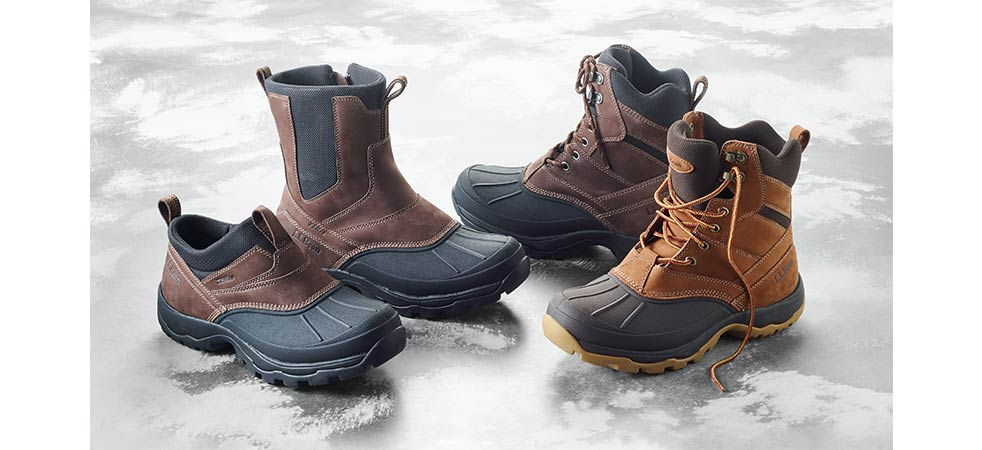 Four insulated L.L.Bean boots on ice.
