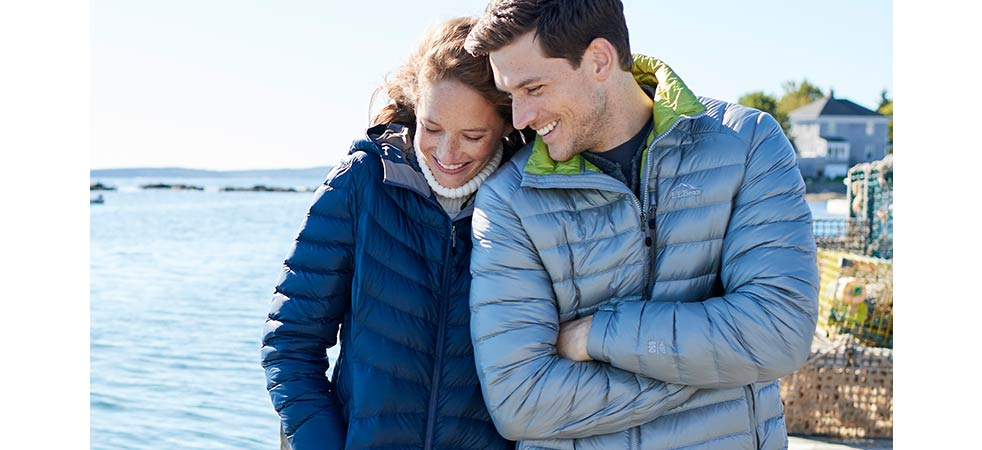 Man and woman on beach in L.L.Bean Ultralight 850 Down Outerwear.