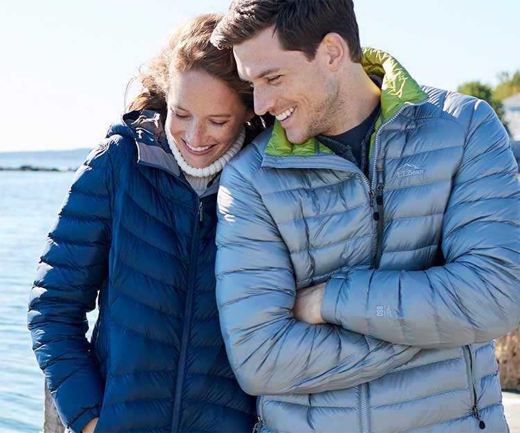Man and Woman walking together outdoors in Ultralight 850 Down Jackets