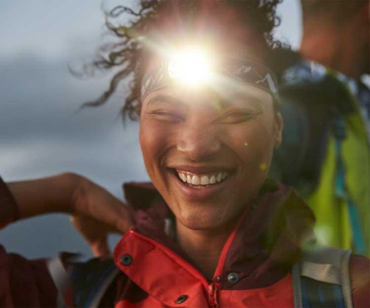 Woman with headlamp shining
