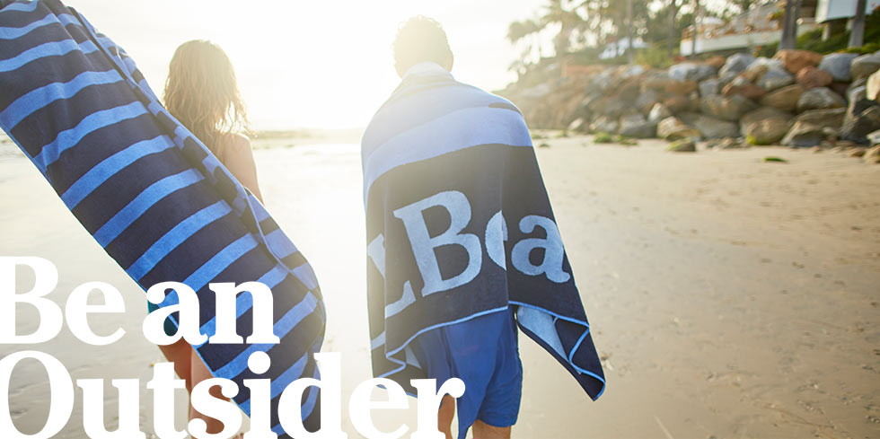 Be an Outsider. Boys walking on a beach with L.L.Bean towels.