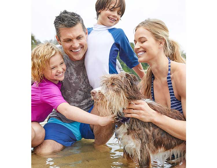 Family and dog swimming.