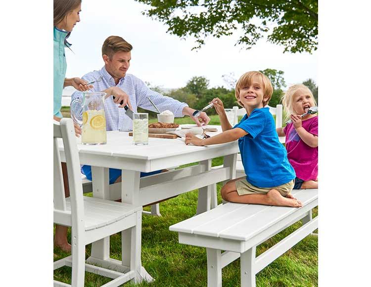 Family eating dinner outside.