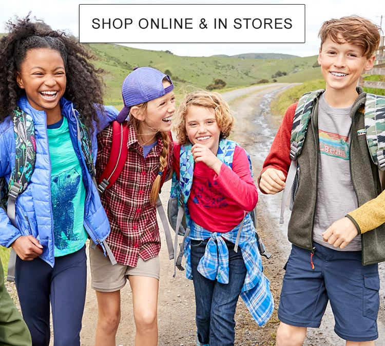 Kids laughing on a hike wearing L.L.Bean clothing and accessories.